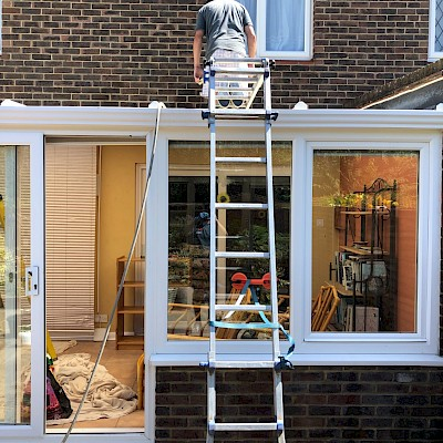 conservatory roof being cleaned in Richmond